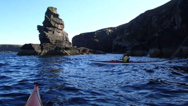 Sea kayaking at a Sea Stack