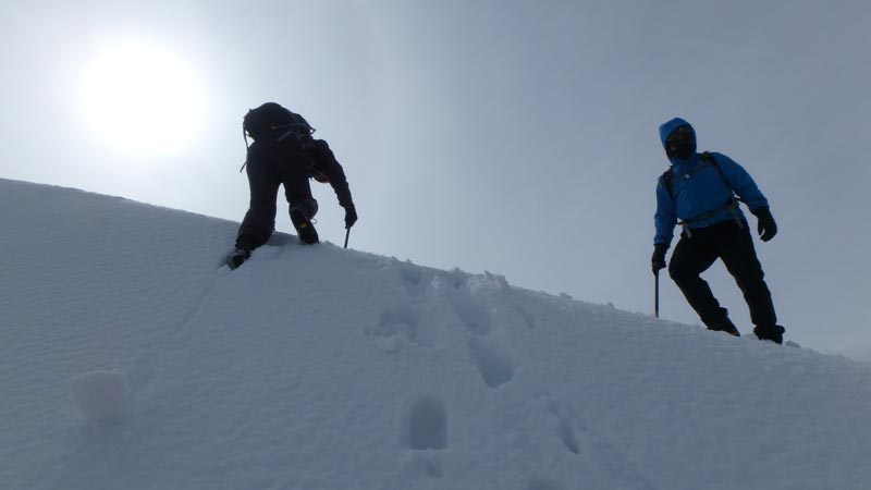 climbing down cornice